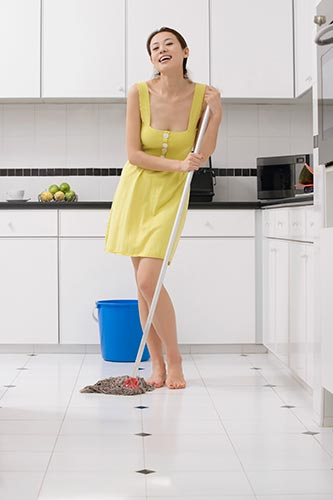 lady-cleaning-kitchen-tiled-floor